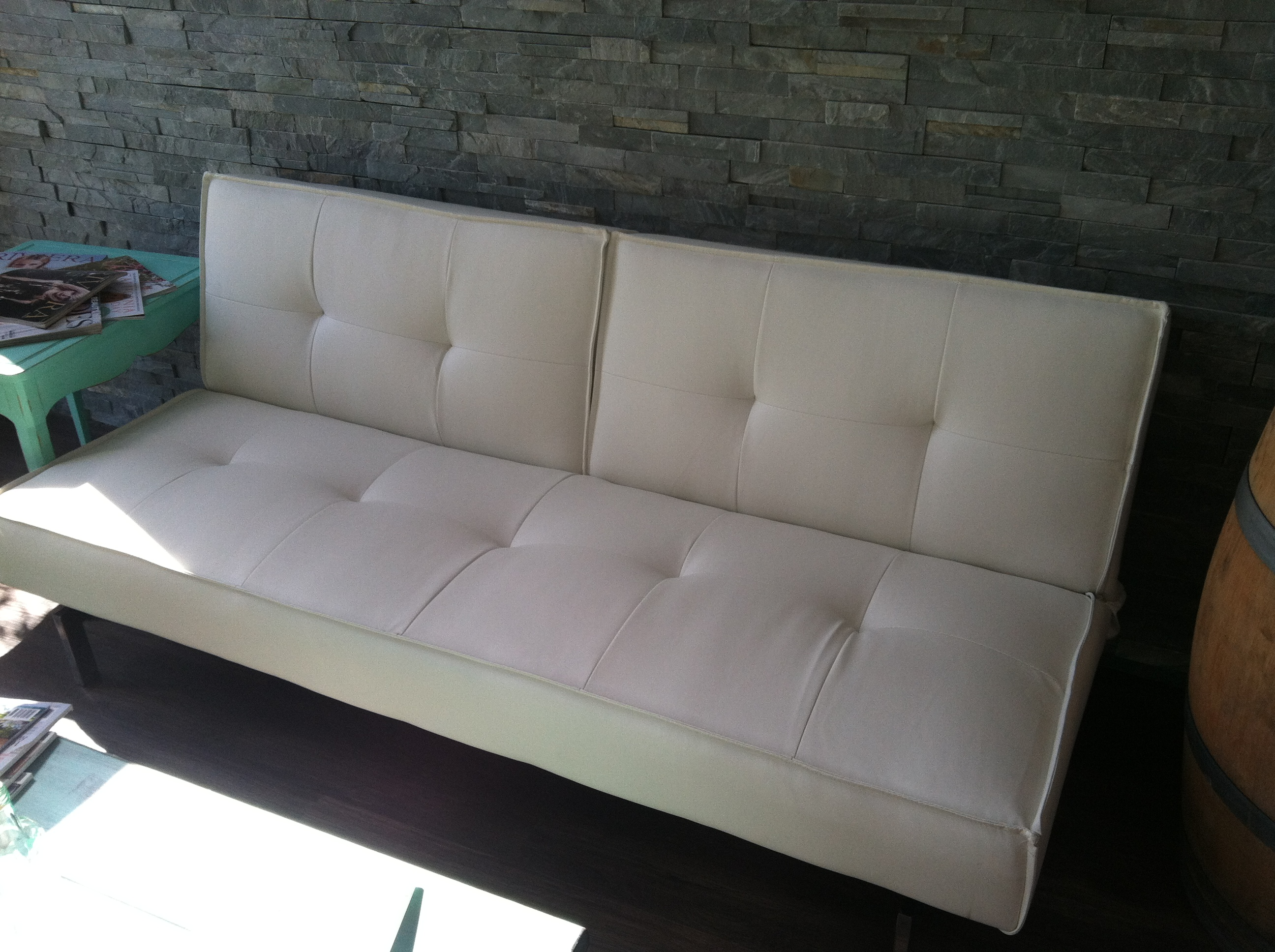 White Leather Split back Couch Opens to a daybed