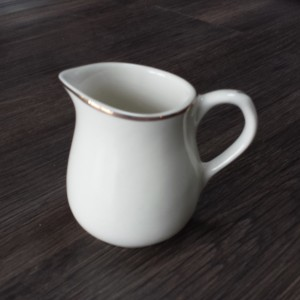 white china creamer pourer with gold rim