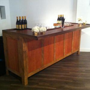 bar and beverage. wood 8 foot bar with shelving
