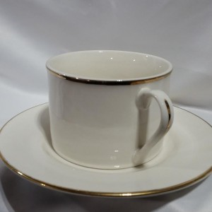gold cogffee cup and saucer