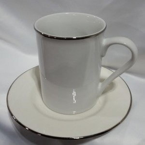 silver coffee cup and saucer